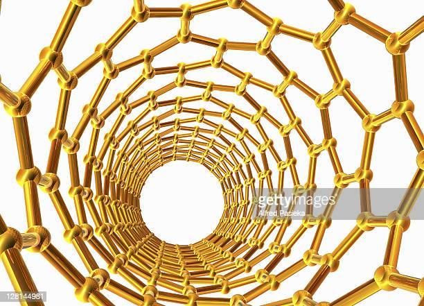 Golden coloured nanotube against white background