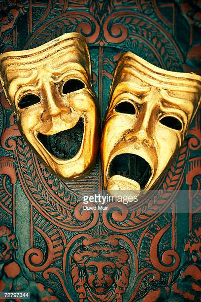 golden comedy and tragedy masks on patterned leather - 悲劇の面 ストックフォトと画像