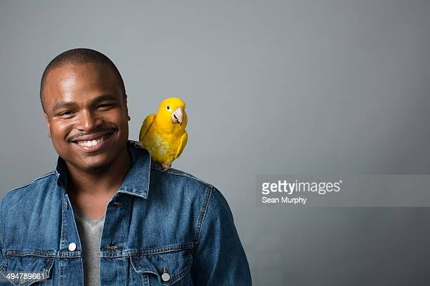 Golden Conure on Man's Shoulder