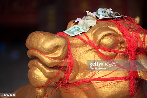 golden cow and mao tse-tung. buddhist temple, kunming, younnan, china - kunming stock pictures, royalty-free photos & images