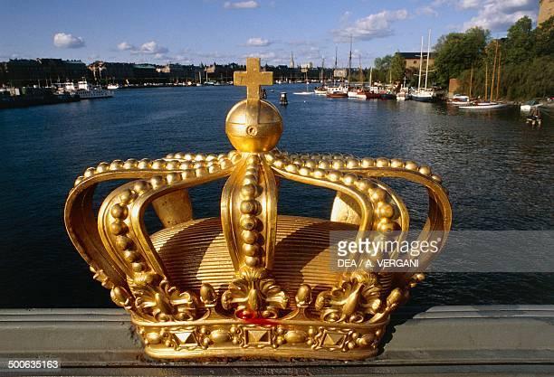 Golden crown on the Skeppsholmsbron bridge Stockholm Sweden
