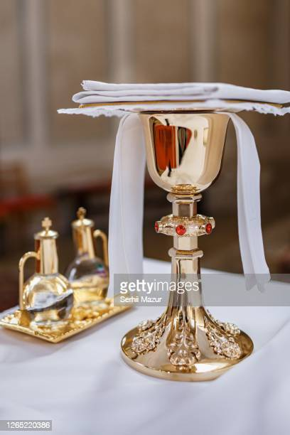 golden cup in church - stock photo - christianity stock pictures, royalty-free photos & images