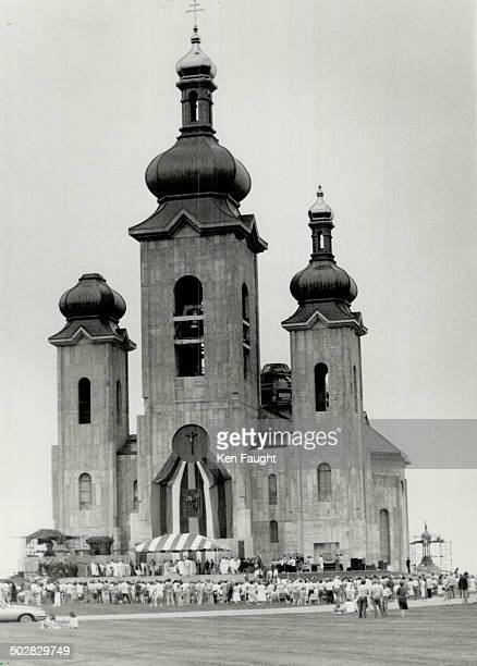 Golden day Beneath two goldplated spires glittering in a gloomy sky thousands of worshippers massed in front of the Church of the Transfiguration in...