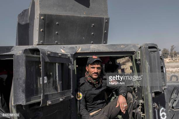 Golden Division battalion officer of the Iraqi Counter Terrorism Service awaits for orders to dvance into west Mosul part of the offensive to retake...