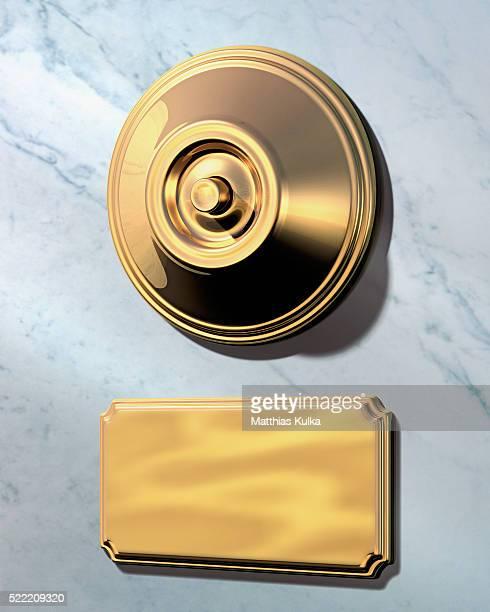 Golden doorbell and nameplate