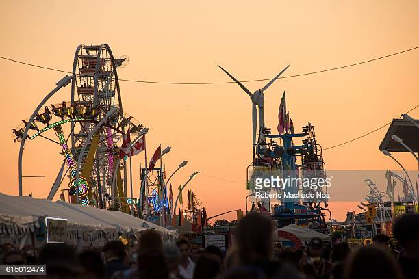 Golden dusk Rides and windmill at the Canadian National Exhibition or CNE traditional Summer festival