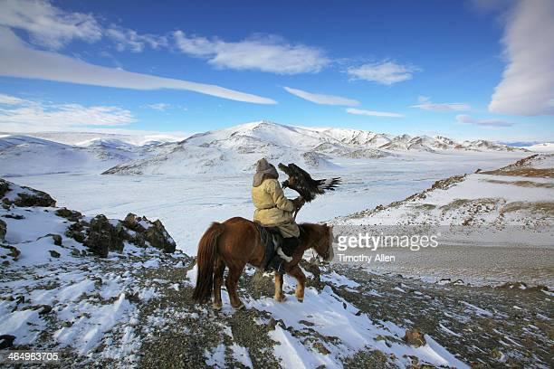 Golden Eagle hunter riding in Altai Mountains