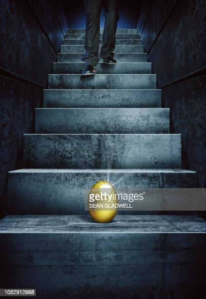 golden egg on steps - antiquities stock pictures, royalty-free photos & images