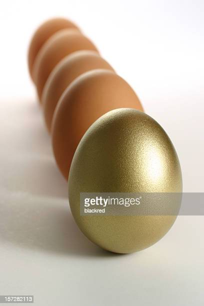 Golden Egg Standing Out from a Row of Ordinary Eggs