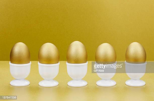 Golden eggs in egg cups