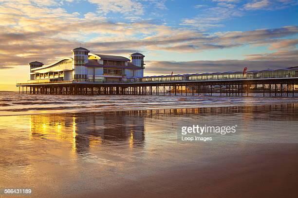Golden evening light falls on the Grand Pier at Weston Super Mare