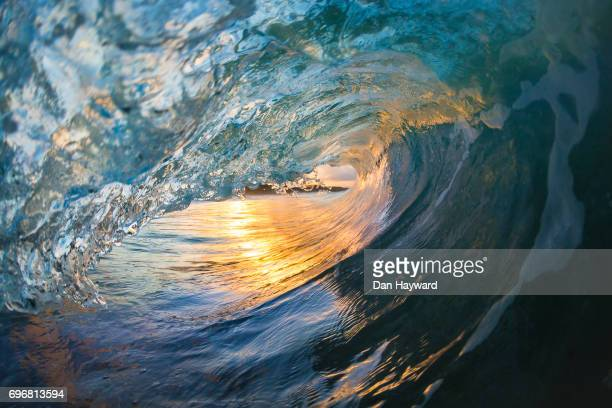 golden eye - breaking wave stock pictures, royalty-free photos & images