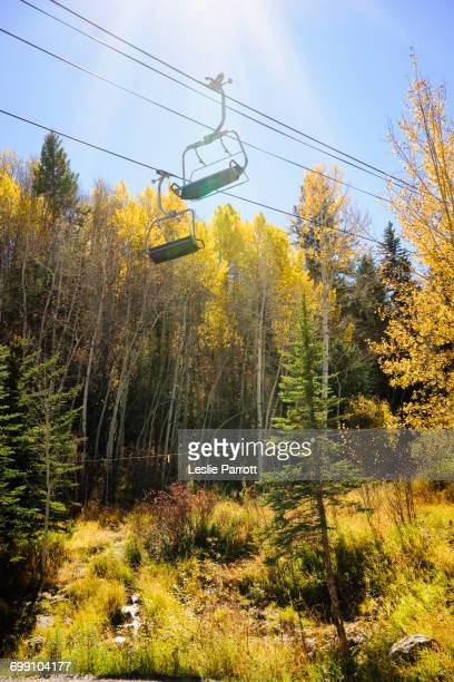 Golden Fall foliage and a ski chair lift