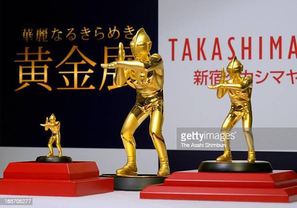 Golden figures of Japanese television series 'Ultraman' are displayed at Shinjuku Takashimaya department store on Octber 24 2013 in Tokyo Japan The...