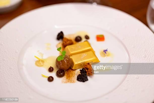 golden foie gras with dried fruit - gras bildbanksfoton och bilder