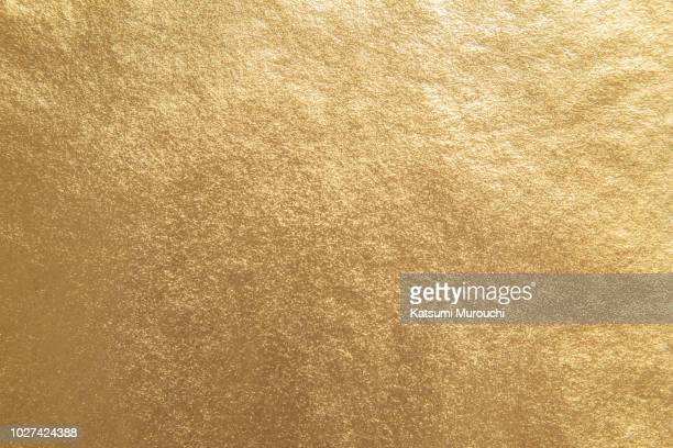 golden foil paper texture background - gold colored stock pictures, royalty-free photos & images