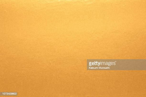 golden foil paper texture background - gold foil stock photos and pictures