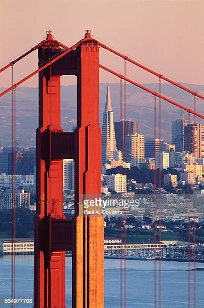 golden gate bridge and san francisco skyline - san francisco california stock pictures, royalty-free photos & images