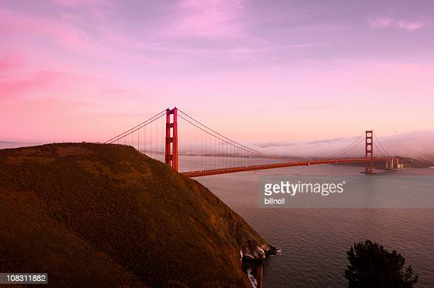 Golden Gate Bridge at sunset with fog