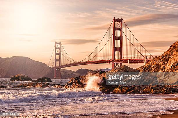 golden gate bridge from baker beach - suspension bridge stock pictures, royalty-free photos & images