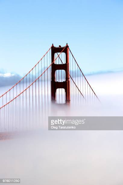 golden gate bridge hidden in fog, san francisco, california, usa - golden gate bridge stock pictures, royalty-free photos & images