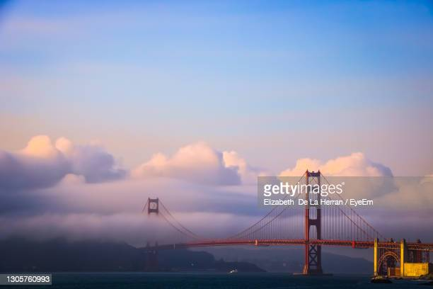 golden gate bridge in the clouds - san francisco california stock pictures, royalty-free photos & images