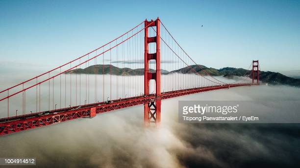 golden gate bridge over river against sky - golden gate bridge stock pictures, royalty-free photos & images