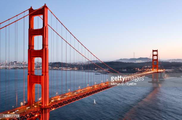 golden gate bridge over river against sky - san francisco california stock photos and pictures