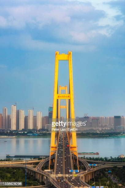 golden gate bridge over sea against sky in city - hubei province stock pictures, royalty-free photos & images