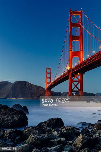 golden gate bridge, san francisco, at sunset - san francisco california stock photos and pictures