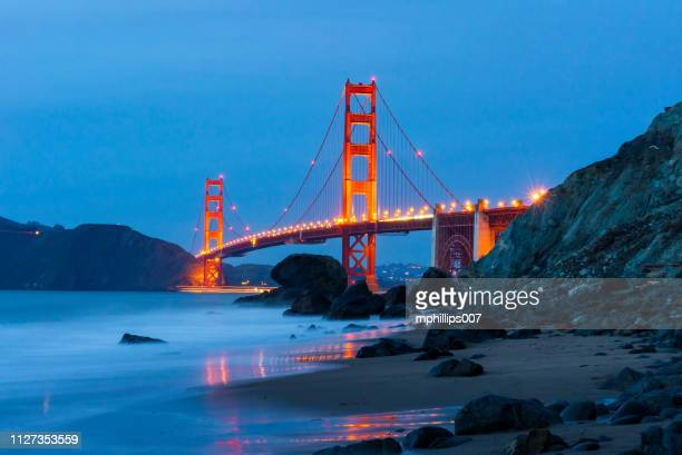 golden gate bridge san francisco night beach - dramatic landscape stock pictures, royalty-free photos & images