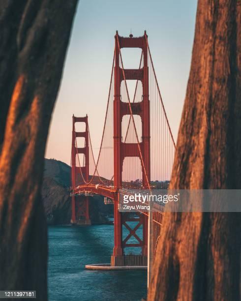 golden gate bridge sunset - san francisco california stock pictures, royalty-free photos & images