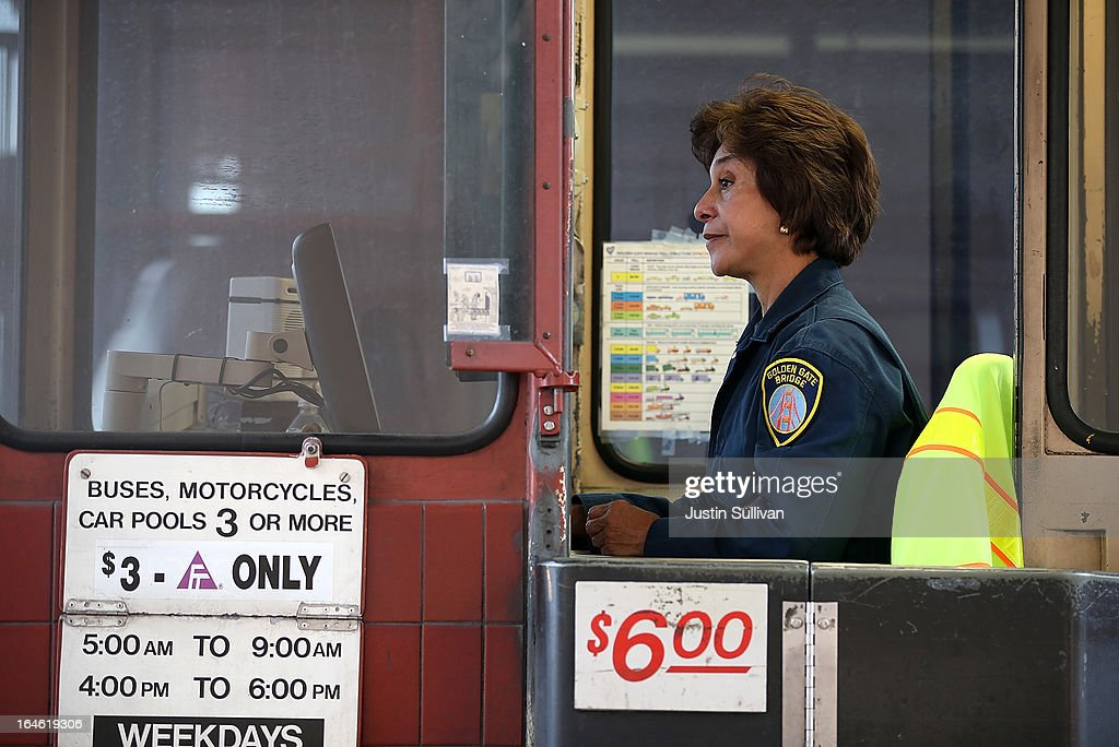 A Golden Gate Bridge toll collector sits in her booth during the morning commute on March 25, 2013 in San Francisco, California. Workers are making last minute changes to the Golden Gate Bridge toll plaza in preparation of making the iconic bridge the first major toll bridge in the nation to go to all electronic tollbooths. The entire staff of full time toll collectors will be replaced by the automated booths starting on March 27.