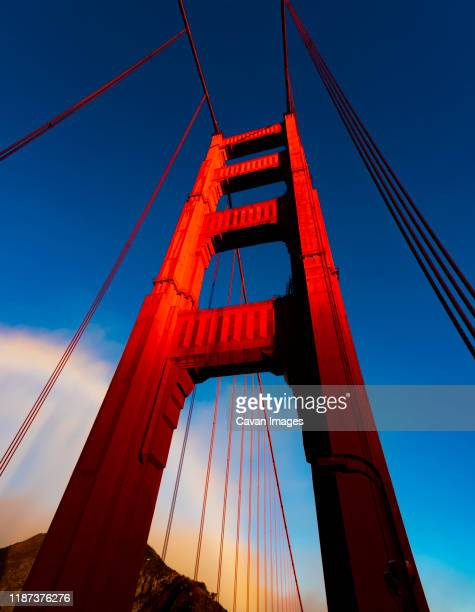 golden gate bridge up close - golden hour stock pictures, royalty-free photos & images