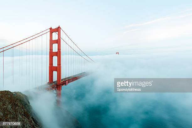 golden gate bridge with low fog, san francisco - suspension bridge stock photos and pictures