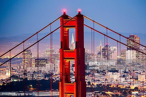 golden gate bridge with san francisco cityscape close up - san francisco california stock photos and pictures