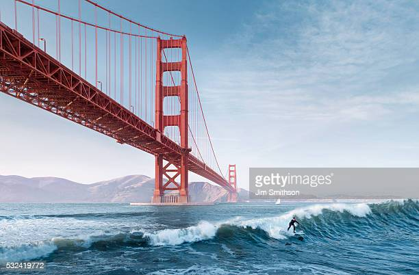 golden gate surfer - golden gate bridge stock pictures, royalty-free photos & images