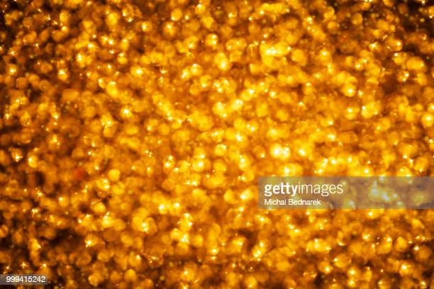 golden glitter background. christmas, new year, party theme - christmas beetle stock pictures, royalty-free photos & images