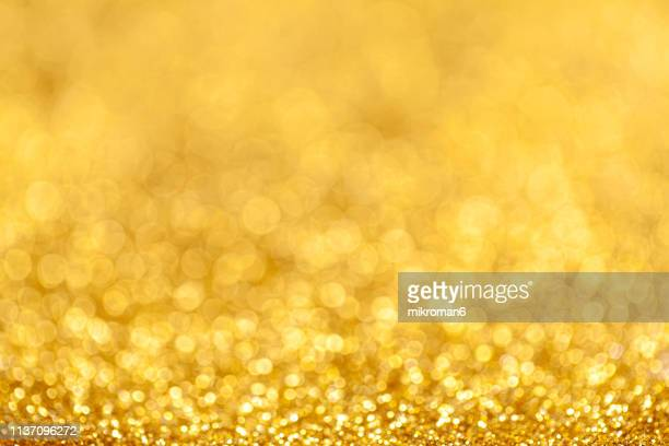 golden glitter background - shiny stock pictures, royalty-free photos & images
