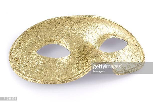 Paillettes d'or brillant masque isolé sur fond blanc