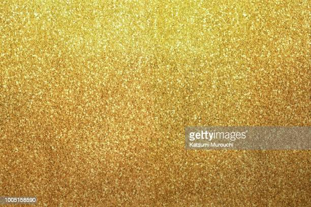 golden glitter texture background - gold colored stock photos and pictures