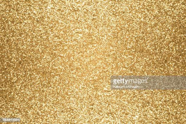 golden glitter textures background - gold colored stock photos and pictures