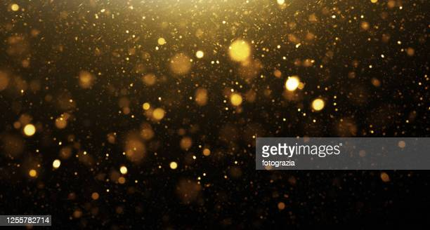 golden glittering background - gold coloured stock pictures, royalty-free photos & images