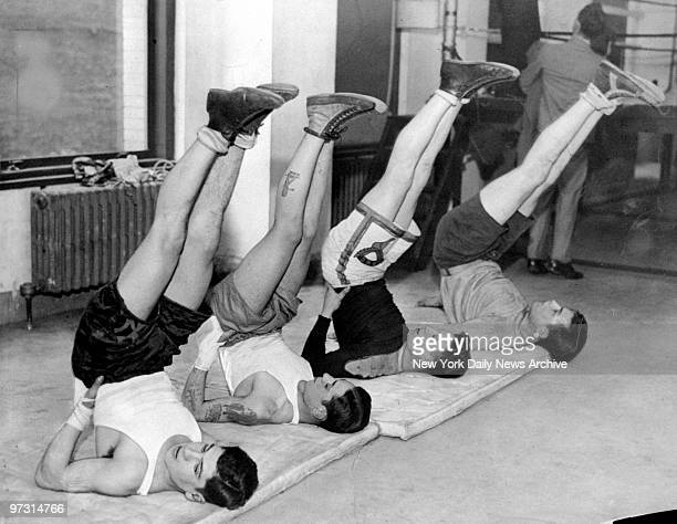 Golden Gloves boxers Jimmy Martin Vince DeLuca Barney Smith and Albie Silverstein exercise at the News Gym