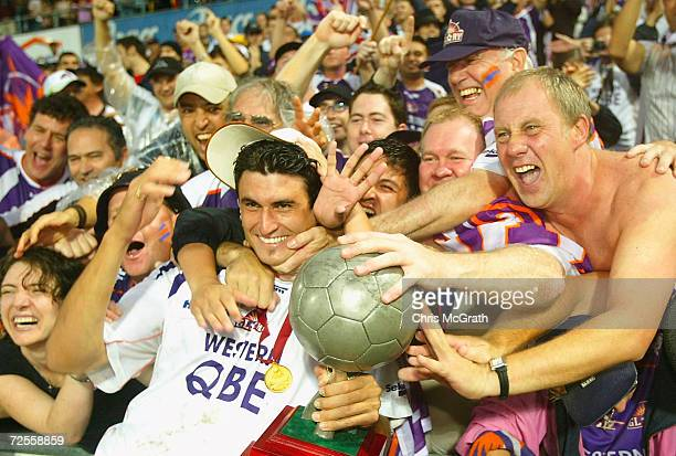 Golden goal scorer Nick Mrdja of the Glory celebrates with fans and the trophy after winning the NSL Grand Final during the NSL Grand Final between...