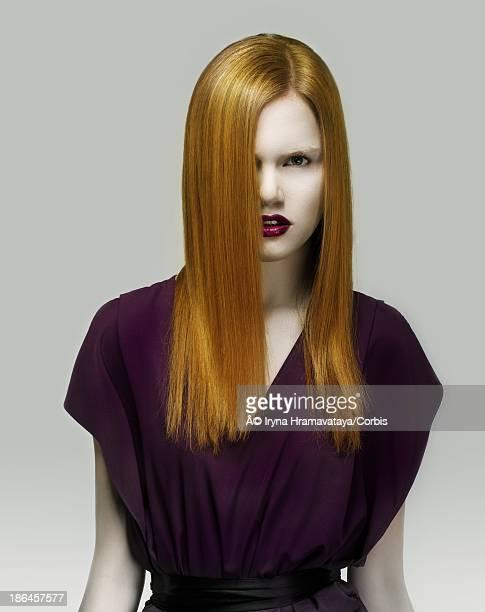Golden hair woman in violet dress