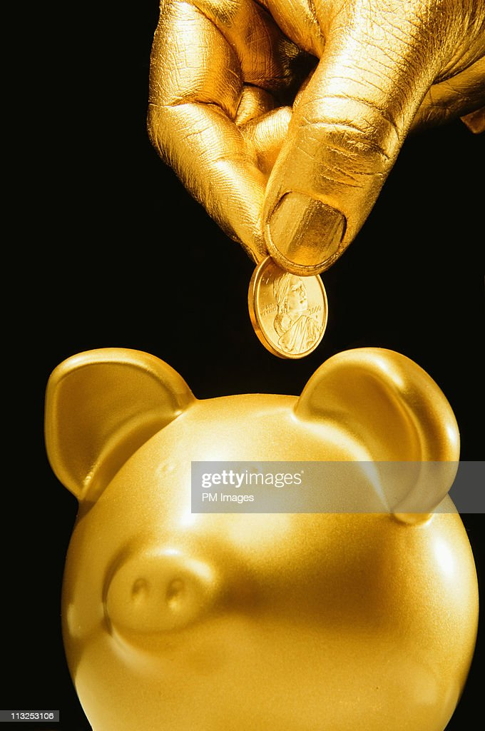 Golden hand, coin and piggy bank : Stockfoto
