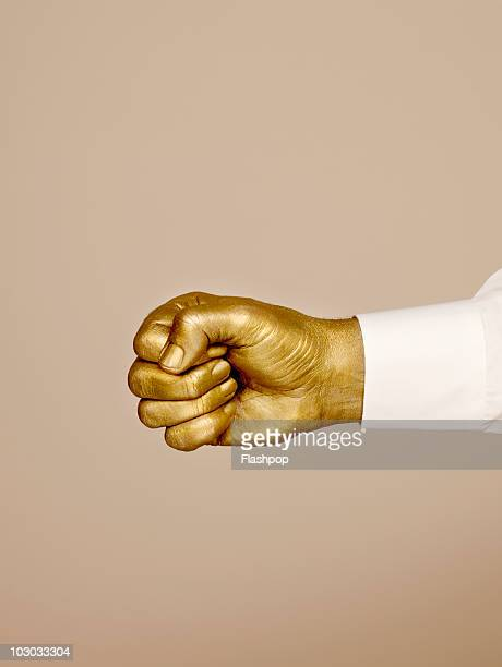 Golden hand with fist clenched