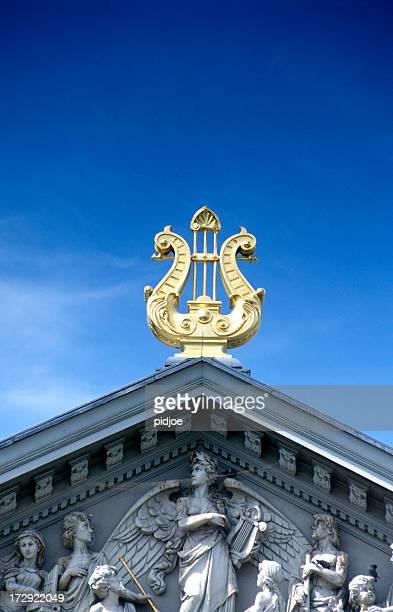 golden harp on top of concert hall