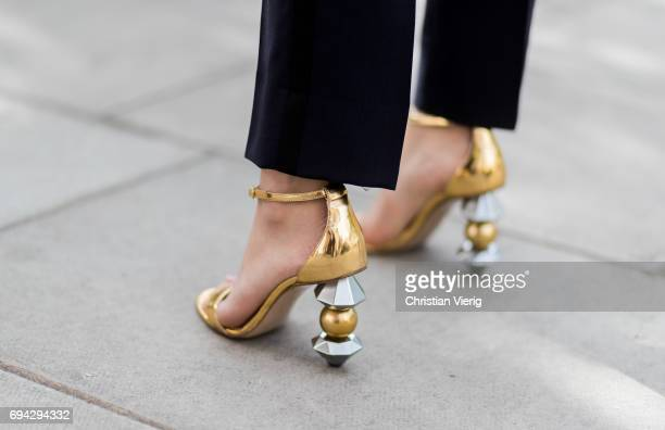 Golden heeled sandals during the London Fashion Week Men's June 2017 collections on June 9 2017 in London England